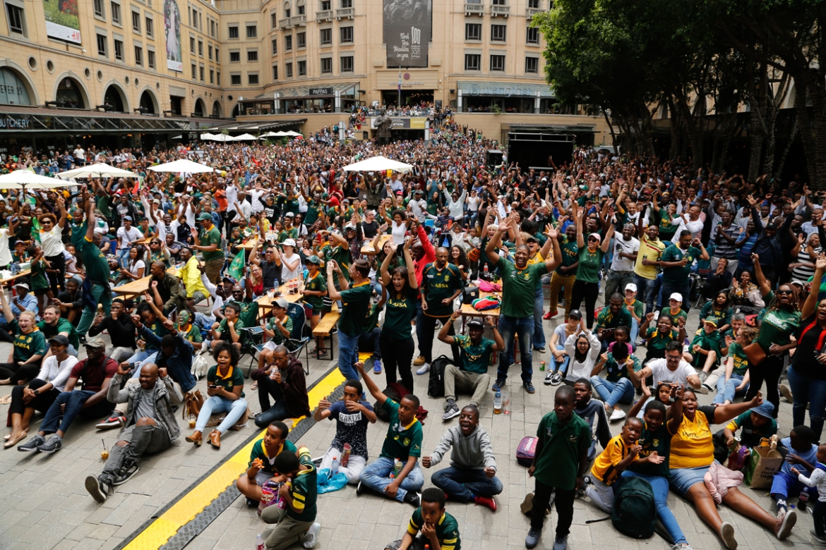 South African fans watching the final on a giant screen at the Nelson Mandela Square in Johannesburg. [Denis Farrell/AP Photo]