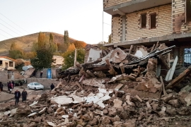 Debris of buildings are seen in the Iranian village of Varnakesh, about 120km (75 miles) southeast of the city of Tabriz, in East Azerbaijan Province [Mohammad Zeinali/Tasnim News/AFP]