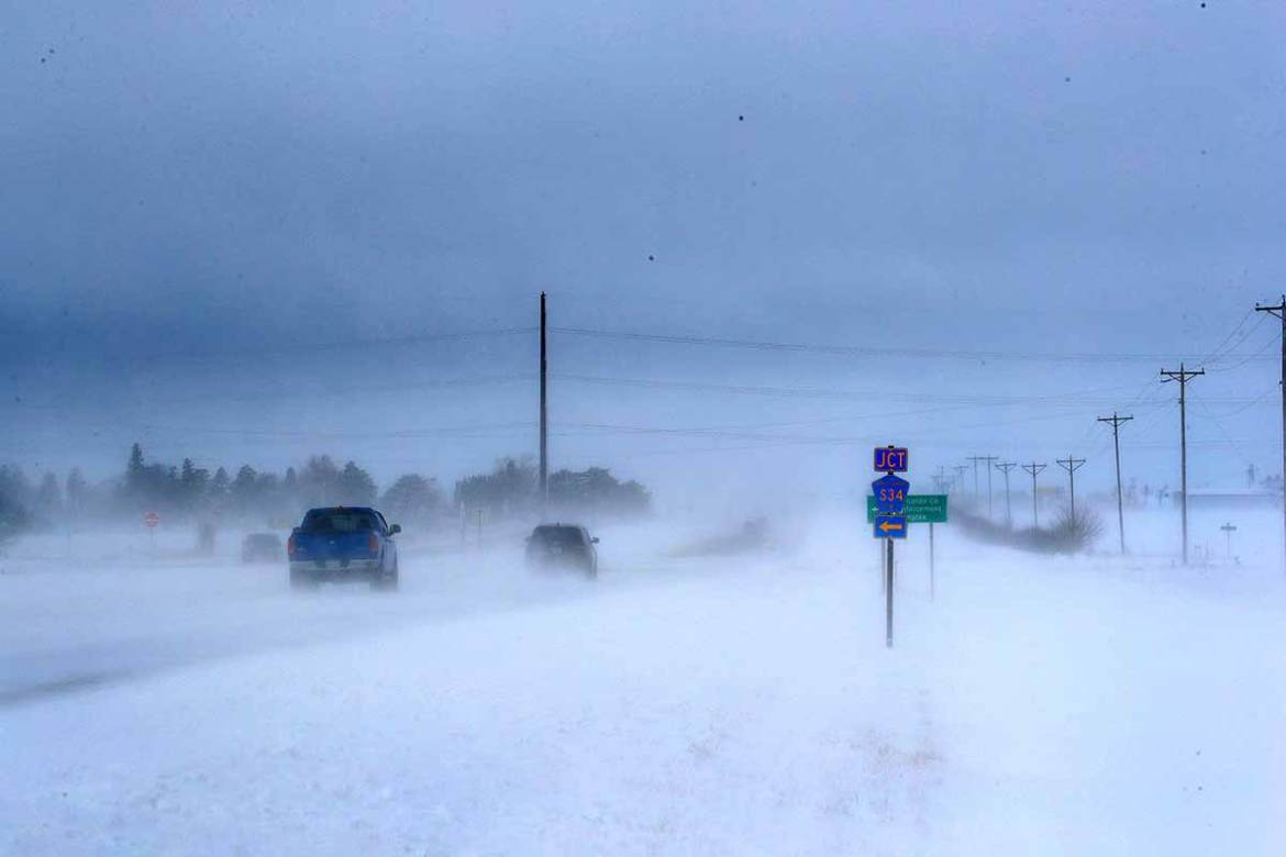 Motorists navigate an ice and snow-covered road in Mason City, Iowa. A storm pushing across the upper Midwest hampered Thanksgiving travel on the busiest holiday of the year.  More than 55 million people take to the roads and skies during the holiday. [Scott Olson/AFP]