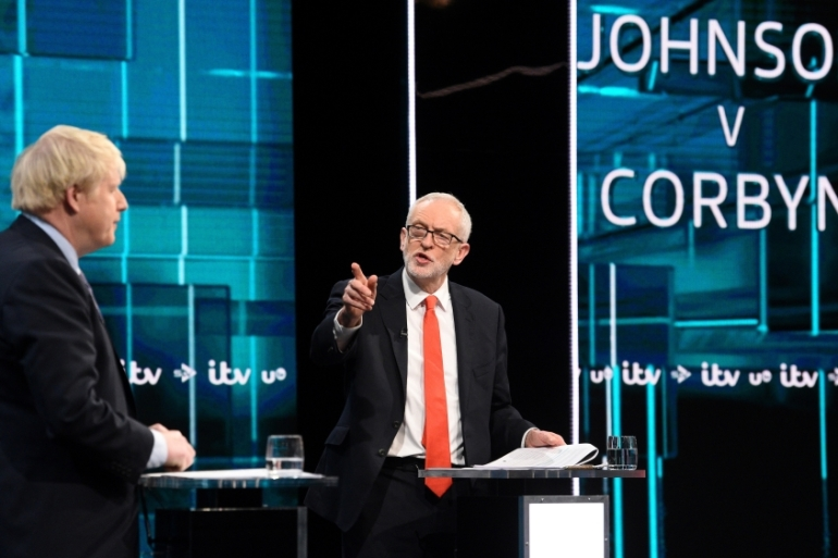 Boris Johnson, left, and Jeremy Corbyn held their first televised debate before the election [Jonathan Hordle/ITV handout via Reuters]