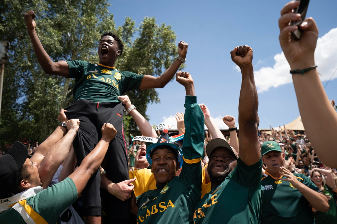 Celebrations at the Pirates Rugby Club in Johannesburg. [Jerome Delay/AP Photo]