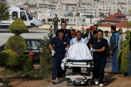 A tourist wounded in the attack is brought to King Hussein Medical Center in Amman on Wednesday [Muhammad Hamed/Reuters]