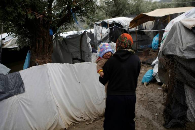 A makeshift city of tents has mushroomed outside the overcrowded official Moria camp on the island of Lesbos [Elias Marcou/Reuters]