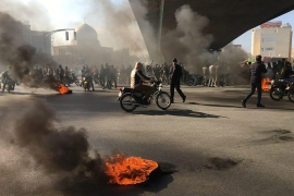 Iranian protesters rally against an increase in petrol prices, in the central city of Isfahan. [AFP]