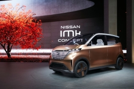Cars like Nissan's iMK concept electric vehicle, shown here at this year's Tokyo Motor Show, highlighted the direction auto giants are taking as they grapple with falling sales and concerns about the environment [Gavin Blair/Al Jazeera]