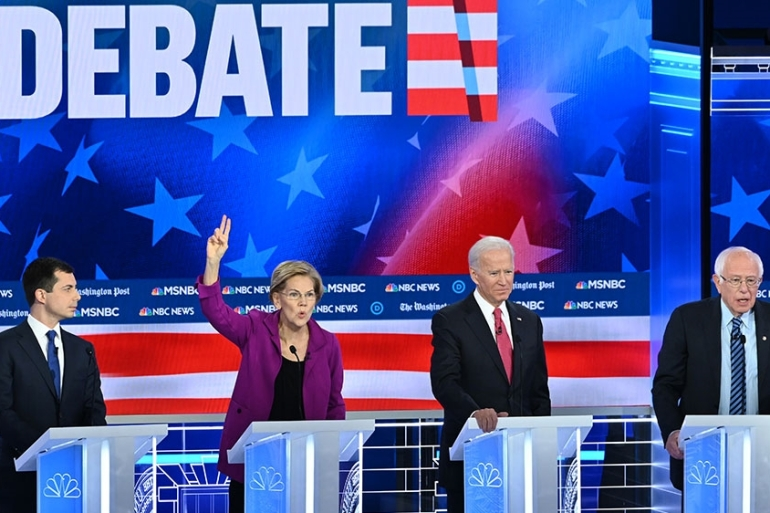 Mayor of South Bend, Indiana, Pete Buttigieg, Senator Elizabeth Warren, Former Vice President Joe Biden and Senator Bernie Sanders participate in the fifth Democratic primary debate [File: Saul Loeb/AFP]