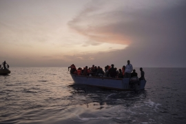Refugees and migrants on an overcrowded boat wait to be rescued by the Ocean Viking humanitarian ship in the Mediterranean Sea [File: Renata Brito/AP]