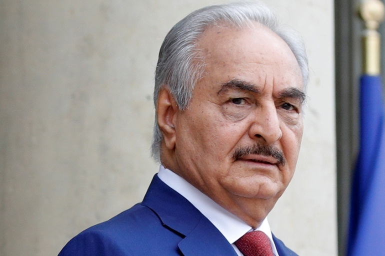 Khalifa Haftar, the military commander who dominates eastern Libya, has said he was willing to attend Berlin summit [File: Philippe Wojazer/Reuters]