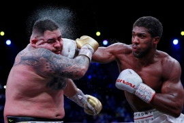 Andy Ruiz Jr takes a punch from Anthony Joshua early on Sunday in Saudi Arabia [Andrew Couldridge via Reuters]
