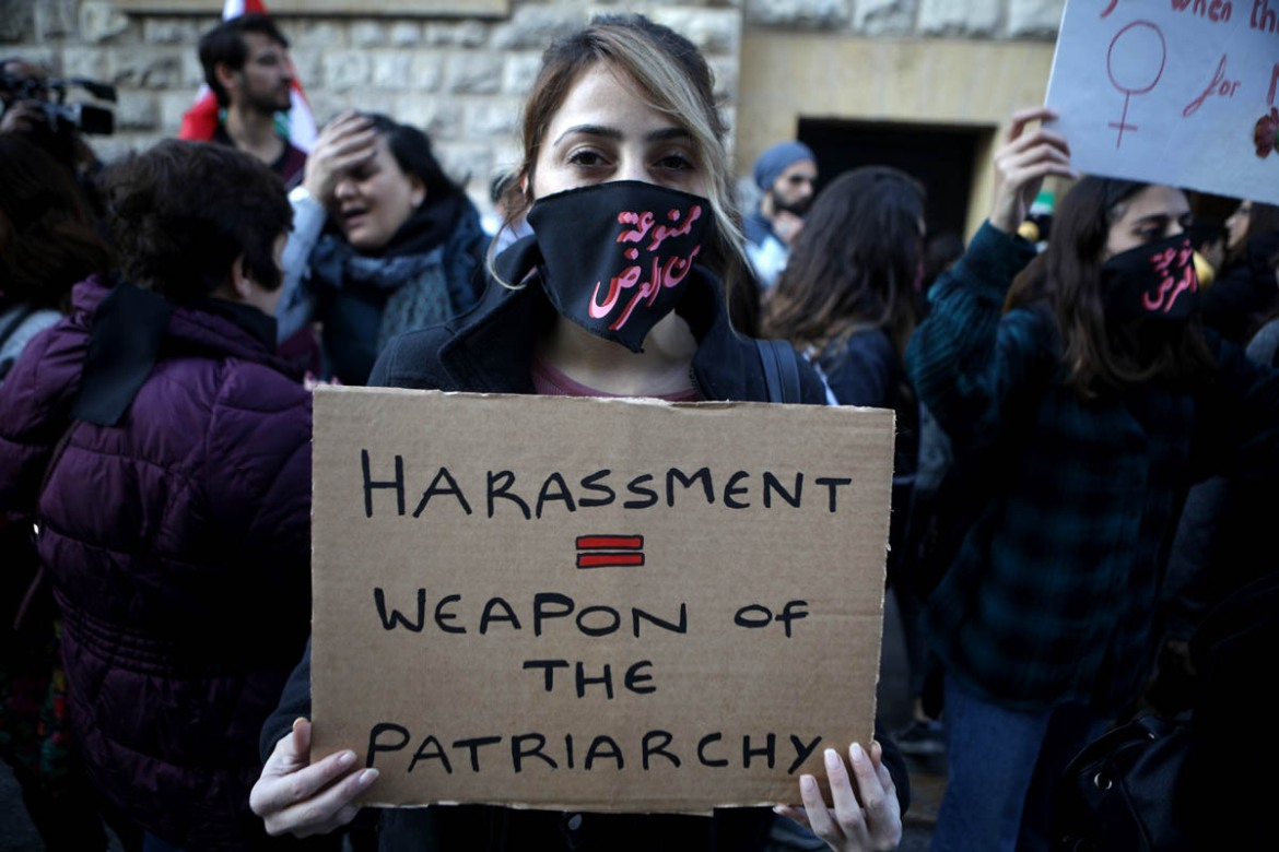 An activist takes part in a demonstration against sexual harassment, rape and domestic violence in the Lebanese capital, Beirut. [Patrick Baz/Abaad/AFP]