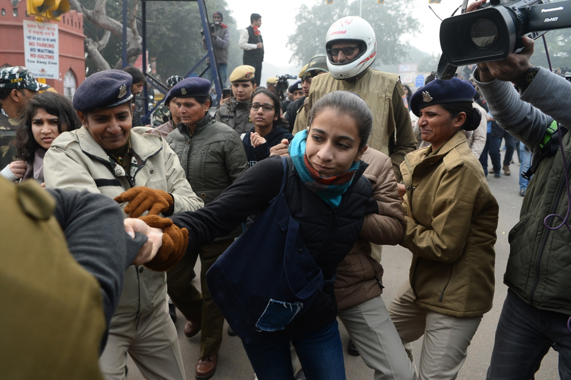 Police detain a woman at a demonstration in national capital New Delhi. [Sajjad Hussain/AFP]