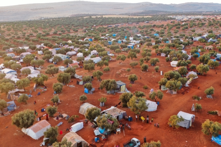 Displaced Syrians living in tents at a squatter camp in Idlib [File: Burak Kara/Getty Images]