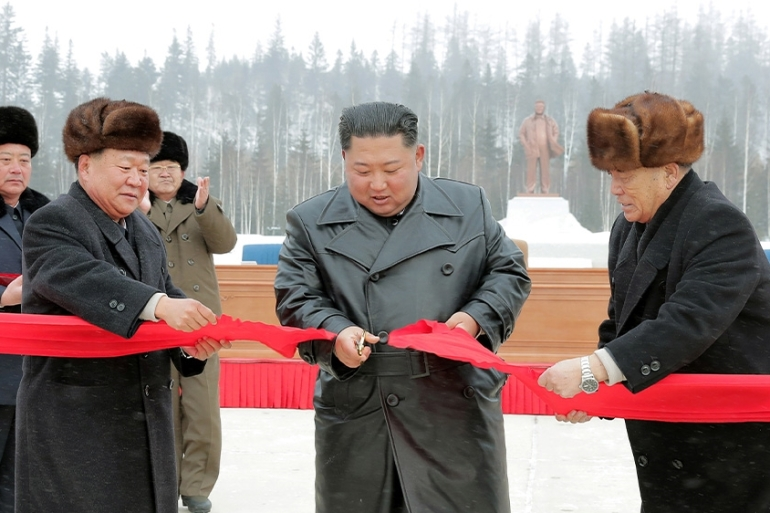 Kim Jong Un cuts a ribbon to launch the town of Samjiyon, a signature project completed despite biting sanctions [KCNA via Reuters]