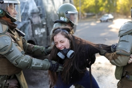 A demonstrator reacts as she is detained by riot policemen during a protest against Chile''s government in Santiago, Chile, November 30, 2019 [Pablo Sanhueza/Reuters]