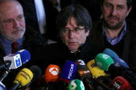 Former Catalan leader Carles Puigdemont joined by former Catalan regional ministers Antoni Comin and Lluis Puig after Monday's hearing at the Justice Palace in Brussels [Yves Herman/Reuters]