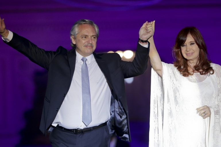 Argentina's President Alberto Fernandez and Vice President Cristina Fernandez de Kirchner wave to supporters outside the presidential palace after winning an election where he promised to revive the South American country's economy [FIle: Daniel Jayo/The Associated Press]
