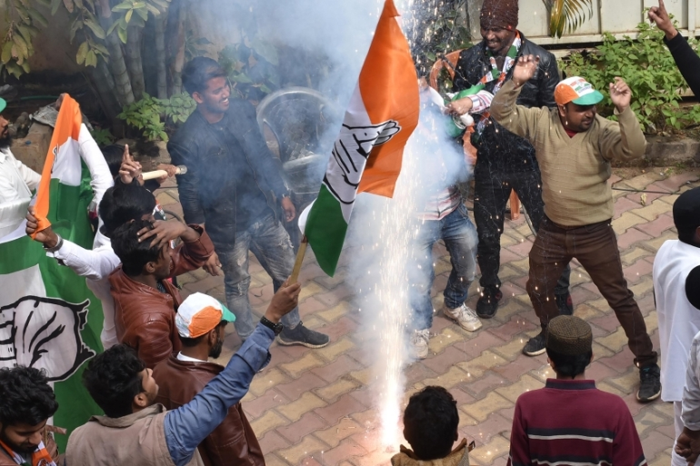 Congress-JMM-RJD alliance workers in Ranchi city celebrate after results of assembly polls were declared [Rajesh Kumar/AFP]