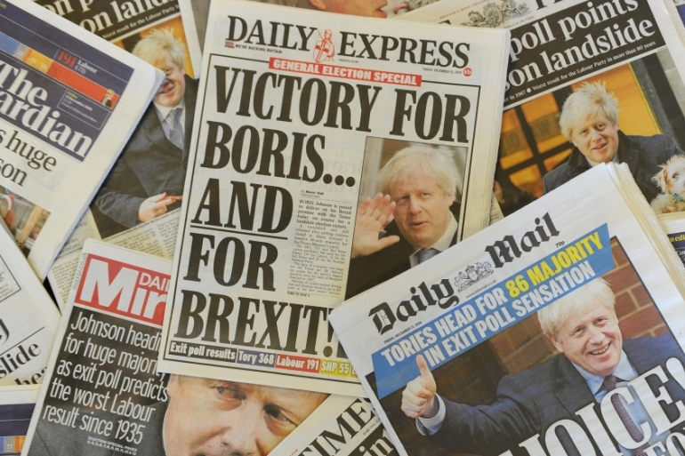 An arrangement of UK daily newspapers on December 13, 2019 shows front-page headlines reporting on the projected election result [Daniel Sorabji/AFP]
