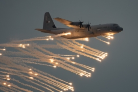 A military aircraft as part of Qatar's National Day celebrations in Doha. [Sorin Furcoi/Al Jazeera]