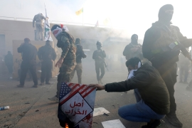 Tensions have risen in Baghdad since Sunday, when the US targeted the Iran-backed militia Kataib Hezbollah in Iraq and Syria, killing at least 25 fighters [Wissm al-Okili/Reuters]