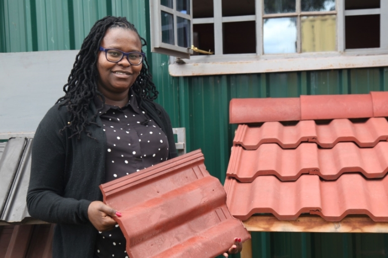 Hope Mwanake, cofounder of Eco Blocks and Tiles, poses for a photo at her factory in Gilgil, Kenya [Thomson Reuters Foundation/Nita Bhalla/Reuters]