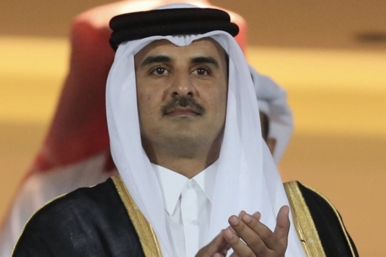 In this file photo, Sheikh Tamim bin Hamad al-Thani attends the 24th Arabian Gulf Cup Final football match between Bahrain and Saudi Arabia in Doha on December 8, 2019 [Qatar Emirate Council handout]