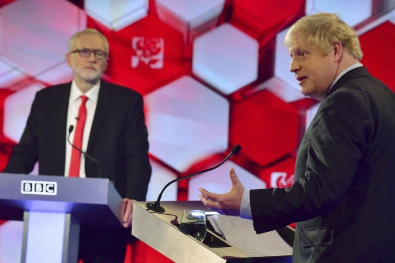 Labour Party leader Jeremy Corbyn and UK Prime Minister Boris Johnson during a live election debate at the BBC TV studios in Maidstone, England on December 6, 2019 [Jeff Overs/BBC via AP]
