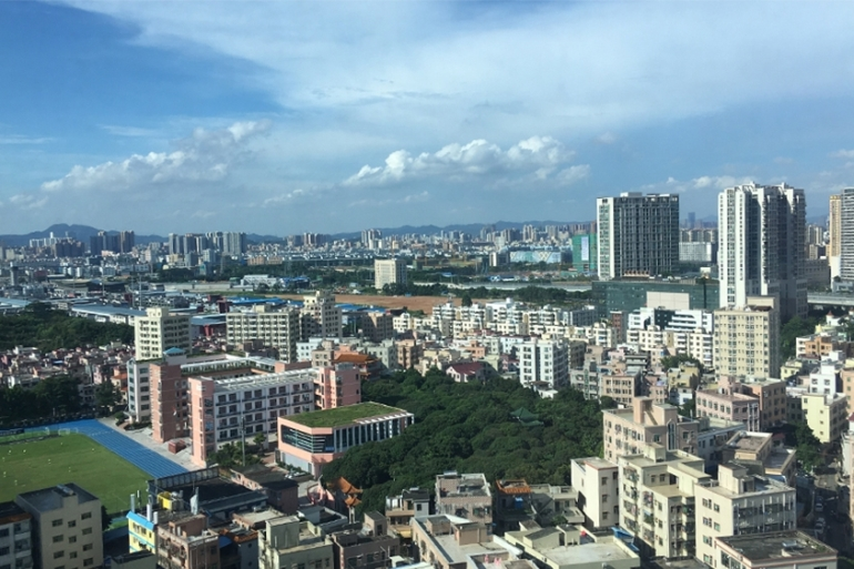 Bogang Village looking north towards the city of Dongguan, Bao'an District, Shenzhen [Michael Standaert/Al Jazeera]