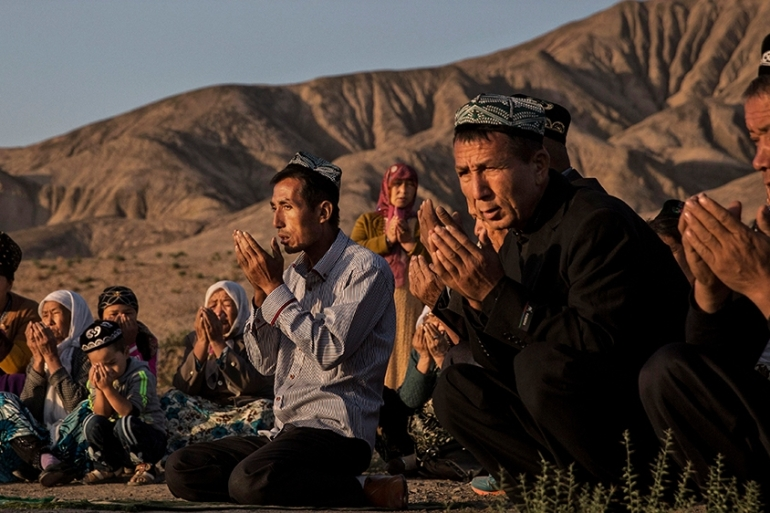 The Uighur bill, which Beijing called a malicious attack on China, requires the US president to condemn abuses against Muslims and calls for the closure of mass detention camps in China's western region of Xinjiang [File: Kevin Frayer/Getty Images]