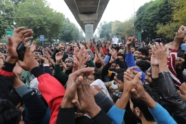 Protesters shout slogans outside the Jamia Millia Islamia university in New Delhi [Rajat Gupta/EPA]