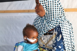 Safiya Jabi and her two-year-old daughter, Inno [Festus Iyorah/Al Jazeera]