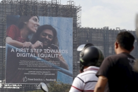 Motorists ride past a billboard displaying Facebook's Free Basics initiative in Mumbai, India, December 30, 2015 [File: Reuters/Danish Siddiqui]