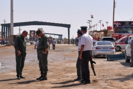 Members of the Syrian security forces gather at the border-crossing between al-Bukamal in Syria and al-Qaim in Iraq, taken from the Syrian side in the eastern region of Deir Az Zor [File: AFP]