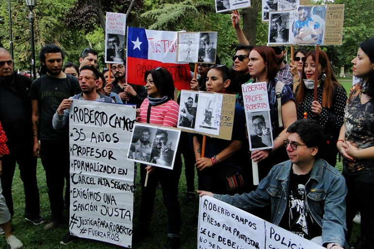 The family and supporters of Campos rally to demand his release [David Arboleda/Al Jazeera]