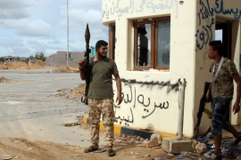 Fighters loyal to the UN-recognised GNA gather at the front line south of Tripoli [File: Mahmud Turkia/AFP]