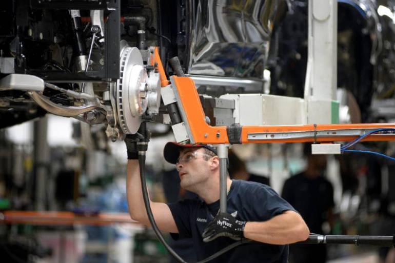 A worker assembles an X model SUV, which BMW says accounts for 44 percent of the brand's sales [File:Charles Mostoller/Reuters]