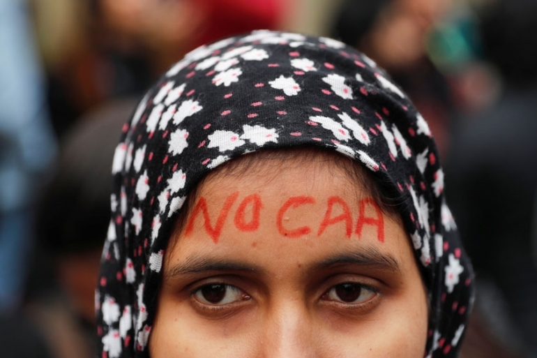 A woman in New Delhi protests against the Citizenship Amendment Act [Adnan Abidi/Reuters]