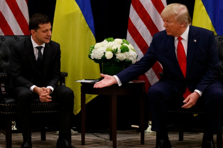 Ukrainian President Volodymyr Zelenskyy met US President Donald Trump in September as a storm began to rage over allegations that led to Trump's impeachment [Evan Vucci/AP]