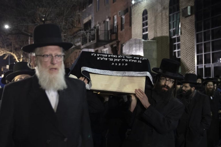 Members of the Orthodox Jewish community mourned the dead on Wednesday [Mark Lennihan/The Associated Press]