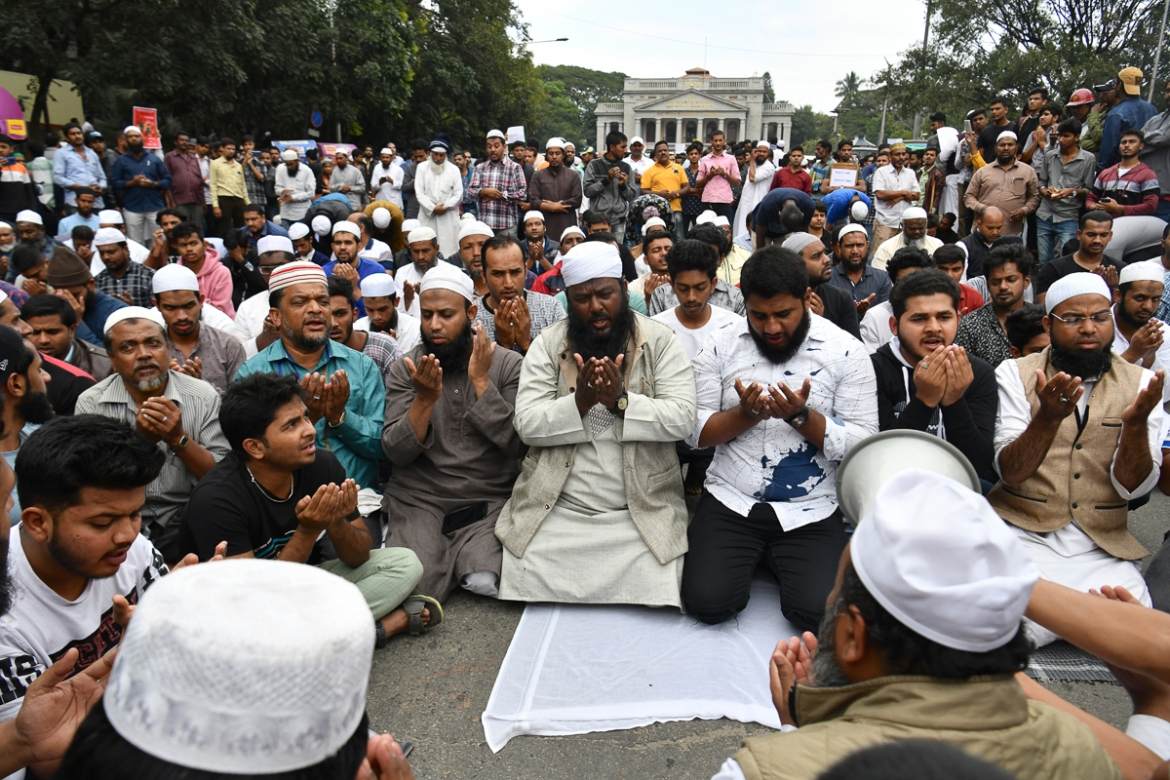 Muslim protesters pray on the street near Bengaluru's Town Hall.[Manjunath Kiran/AFP]