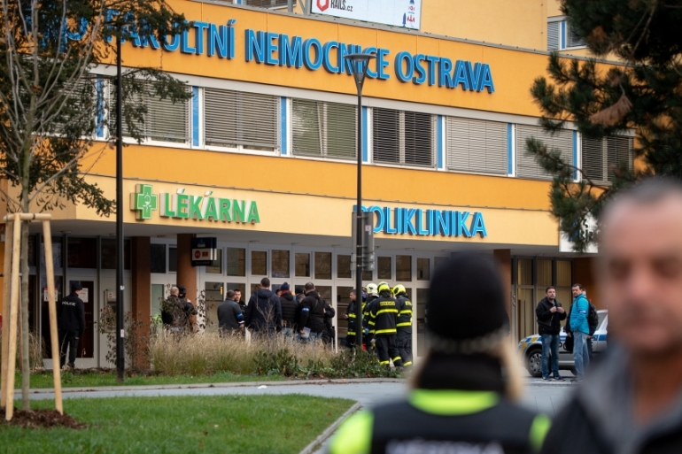 Police officers stand guard near the site of a shooting in front of a hospital in Ostrava, Czech Republic [Lukas Kabon/Reuters]