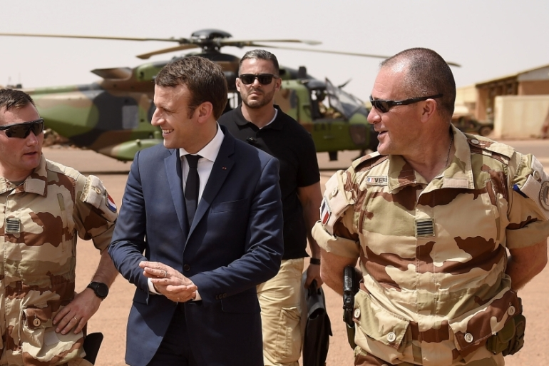 French President Emmanuel Macron and Foreign Minister Jean-Yves Le Drian visit the troops of France's Barkhane operation in Africa's Sahel region [File: Christophe Petit Tesson/Reuters]