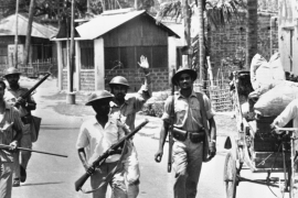 Uniformed East Pakistan rebel forces with armed civilians patrol a street in Jessore, East Pakistan on April 2, 1971 after West Pakistan forces withdrew [AP]