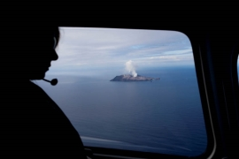 Authorities say eight bodies remain on the volcano after it erupted on Monday [Jorge Silva/Reuters]