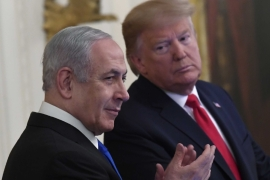United States President Donald Trump looks to Israeli Prime Minister Benjamin Netanyahu during an event at the White House to announce a Middle East peace plan on January 28, 2020 [AP/Susan Walsh]