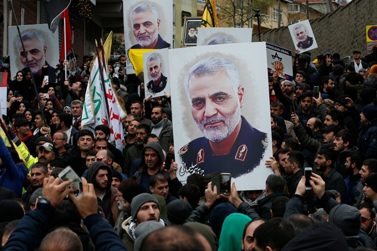 "Protesters gather during a demonstration against the killing of Iranian Revolutionary Guard Gen. Qassem Soleimani, close to United States'' consulate in Istanbul, Sunday, Jan. 5, 2020. Iran has vowed ""harsh retaliation"" for the U.S. airstrike near Baghdad''s airport that killed Soleimani, Tehran''s top general and the architect of its interventions across the Middle East, as tensions soar in the wake of the targeted killing.(AP Photo/Lefteris Pitarakis) [The Associated Press]"