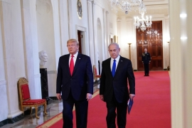 US President Donald Trump and Israeli Prime Minister Benjamin Netanyahu arrive for an announcement of Trump's Middle East plan in the East Room of the White House in Washington [Mandel Ngan/AFP]