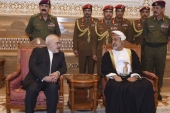 Oman's Sultan Haitham receives Iranian Foreign Minister Javad Zarif after his arrival to attend an official mourning ceremony for the late Sultan Qaboos, in Muscat, Oman on January 12 [AP]