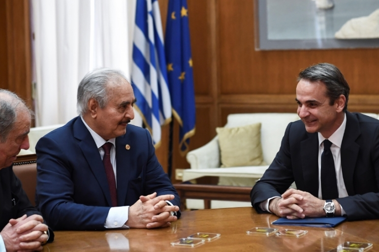 Libyan strongman Khalifa Haftar, left, speaks with Greek Prime Minister Kyriakos Mitsotakis during talks in Athens, on January 17, 2020 [Aris Messinis/AFP]