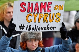 Protesters supporting a British woman found guilty of lying in a rape case in Cyprus, take part in a march in London on January 6, 2020 [Reuters/Toby Melville]